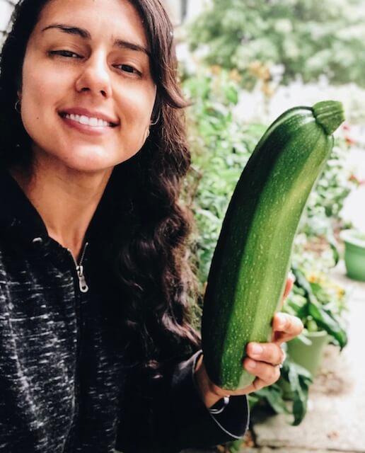a women holding a Zucchini
