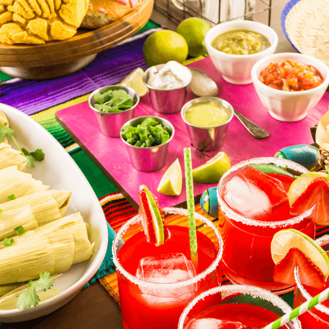 a table full of taco fillings and mexican drinks